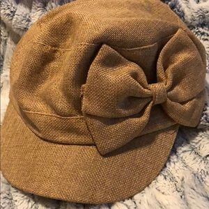 Tan hat with bow